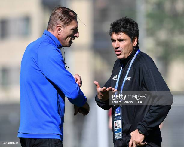 Massimo Busacca FIFA head of Refeering talks with a referee at training session of Video Assistant Referees on June 15 2017 in St Petersburg Russia