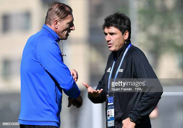 Massimo Busacca, FIFA head of Refereering talks with a referee at training session of Video Assistant Referees on June 15, 2017 in St. Petersburg,...