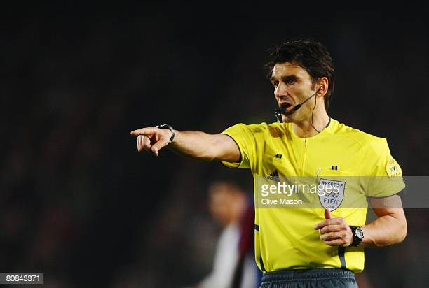 Massimo Busacca the match referee gives a decision during the UEFA Champions League Semi-Final, first leg match between Barcelona and Manchester...