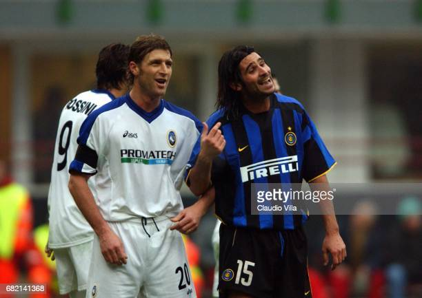 Massimo Carrera of Atalanta and Adani of Inter chat during the SERIE A 14th Round League match between Inter and Atalanta played at the San Siro...