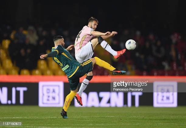 Massimo Coda of Benevento fights for the ball with Przemyslaw Szyminski of US Citta di Palermo during the Serie B match between Benevento and US...
