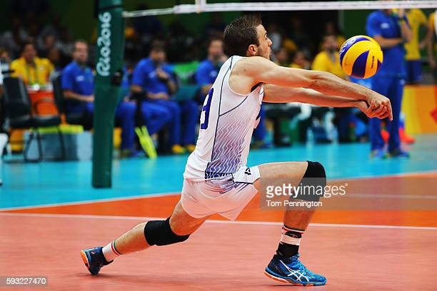 Massimo Colaci of Italy sets the ball during the Men's Gold Medal Match between Italy and Brazil on Day 16 of the Rio 2016 Olympic Games at...