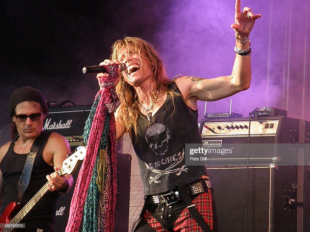 Massimo Conti and Renzo D'Aprano of italian Aerosmith tribute band Big Ones perform on stage at Silverstone Classic at Silverstone on July 25, 2014 in Northampton, United Kingdom.