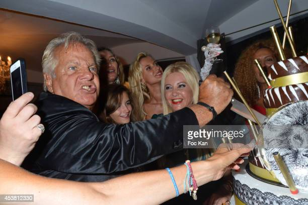 Massimo Gargia and Monika Bacardi attend the Massimo Gargia Birthday Party at the VIP Room Saint Tropez on August 18 2014 in Saint Tropez France