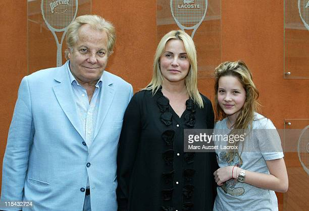 Massimo Gargia Sophie Favier and daugther CarlaMarie pose in the 'Village' the VIP area of the French Open at Roland Garros arena in Paris France on...