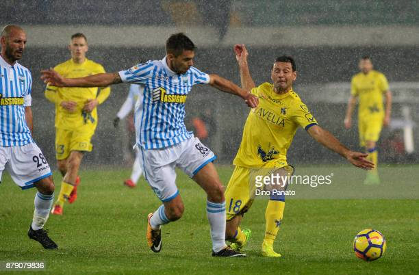 Massimo Gobbi of Chievo Verona competes with Alberto Grassi of Spal during the Serie A match between AC Chievo Verona and Spal at Stadio Marc'Antonio...
