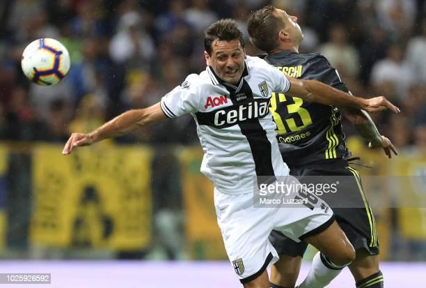 Massimo Gobbi of Parma Calcio competes for the ball with Federico Bernardeschi of Juventus FC during the serie A match between Parma Calcio and...