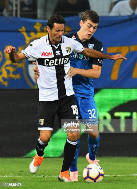 Massimo Gobbi of Parma Calcio competes for the ball with Jabok Rasmussen of Empoli Fc during the Serie A match between Parma Calcio and Empoli at...
