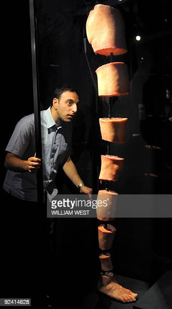 Massimo Ingrosso inspects a dissected leg at a Leonardo Da Vinci exhibition titled 'Anatomy to Robots' in Melbourne on October 28 a world premiere...