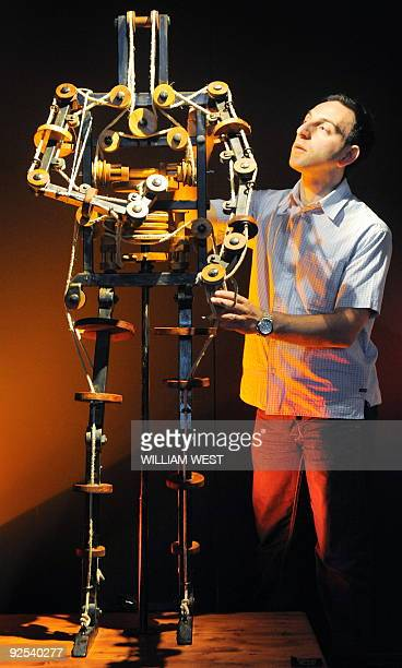 Massimo Ingrosso inspects the complete mechanism of a robot at a Leonardo Da Vinci exhibition in Melbourne on October 28 2009 titled 'Anatomy to...