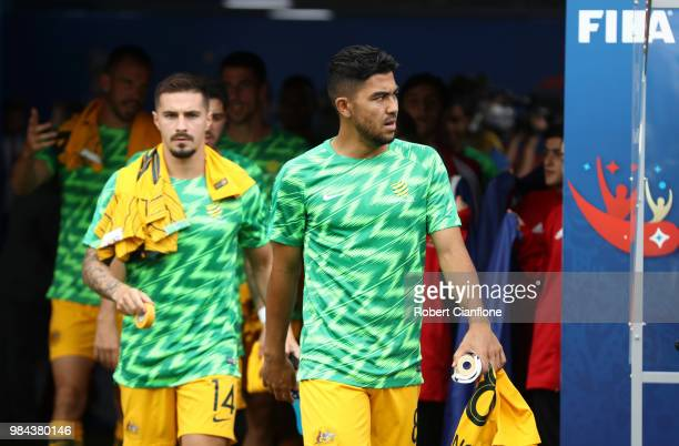 Massimo Luongo of Australia and Jamie MacLaren of Australia walk out to warm up prior to the 2018 FIFA World Cup Russia group C match between...