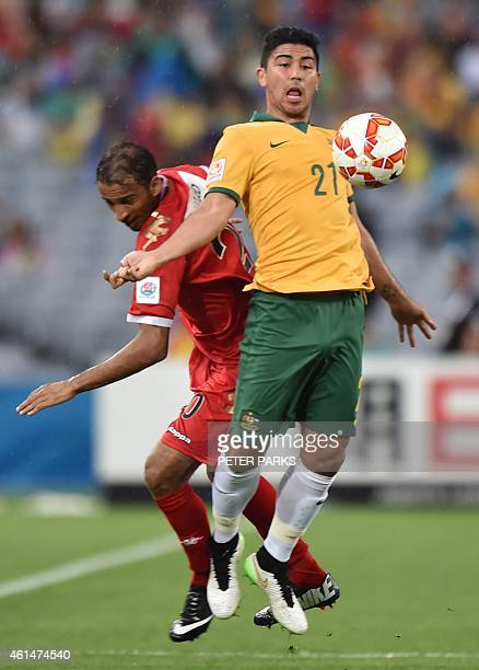 Massimo Luongo of Australia and Mohammed Al Musalami of Oman fight for the ball during their Group A football match at the AFC Asian Cup in Sydney on...