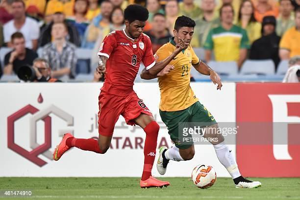 Massimo Luongo of Australia and Raed Saleh of Oman fight for the ball during their Group A football match at the AFC Asian Cup in Sydney on January...