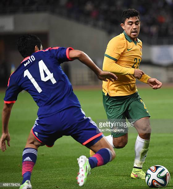 Massimo Luongo of Australia and Yoshinori Muto of Japan compete for the ball during the international friendly match between Japan and Australia at...