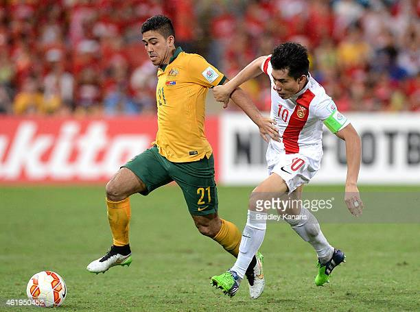 Massimo Luongo of Australia and Zheng Zhi of China compete for the ball during the 2015 Asian Cup match between China PR and the Australian Socceroos...