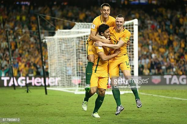 Massimo Luongo of Australia celebrates scoring a goal with Christopher Ikonomidis of Australia and Brad Smith of Australia during the 2018 FIFA World...