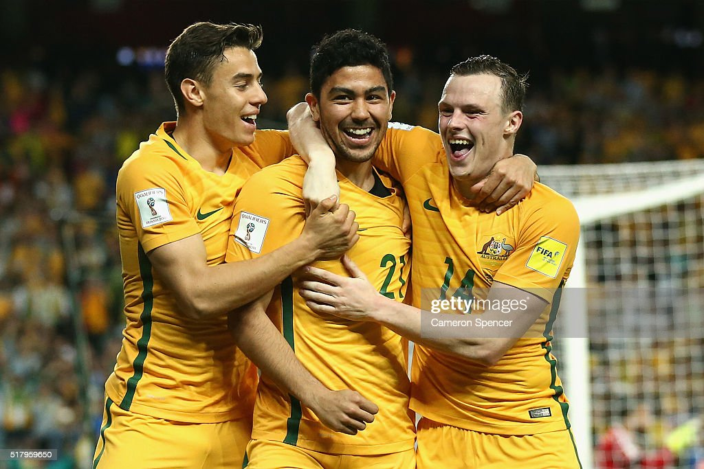 Massimo Luongo of Australia celebrates scoring a goal with Christopher Ikonomidis of Australia and Brad Smith of Australia during the 2018 FIFA World Cup Qualification match between the Australian Socceroos and Jordan at Allianz Stadium on March 29, 2016 in Sydney, Australia.