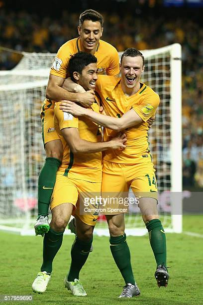 Massimo Luongo of Australia celebrates scoring a goal with team mates Christopher Ikonomidis and Brad Smith during the 2018 FIFA World Cup...