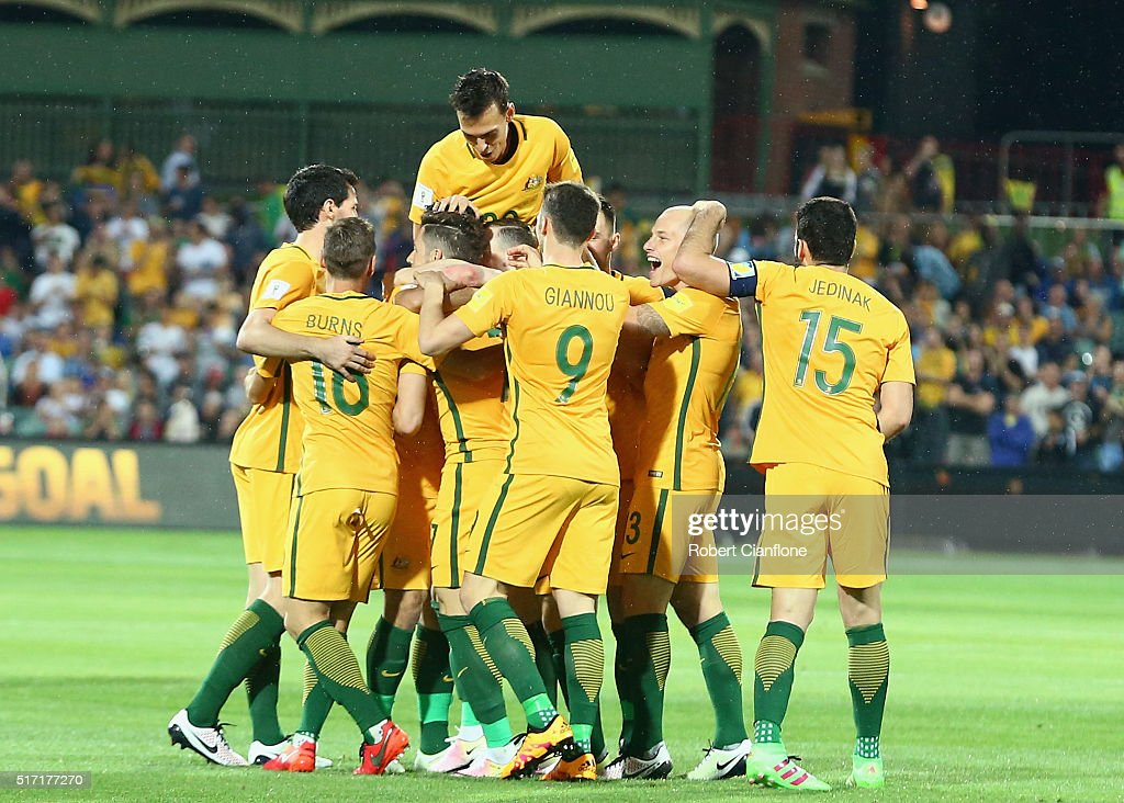 Massimo Luongo of Australia celebrates with team mates after scoring a goal during the 2018 FIFA World Cup Qualification match between the Australia Socceroos and Tajikistan at the Adelaide Oval on March 24, 2016 in Adelaide, Australia.
