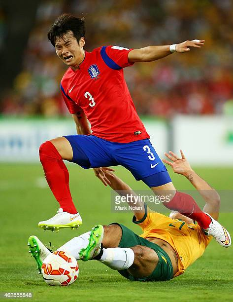 Massimo Luongo of Australia challenges Kim Jin Su of Korea Republic during the 2015 Asian Cup final match between Korea Republic and the Australian...
