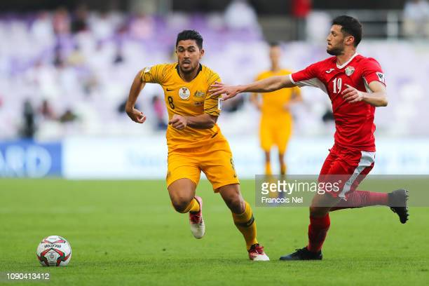 Massimo Luongo of Australia competes for the ball with Anas Bani Yaseen of Jordan during the AFC Asian Cup Group B match between Australia and Jordan...