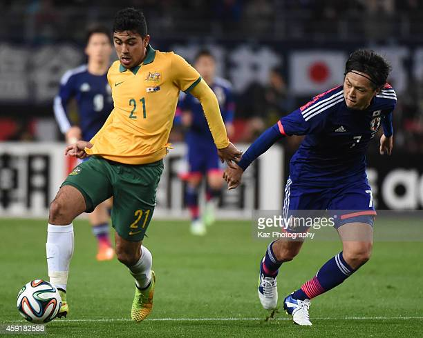 Massimo Luongo of Australia dribbles the ball under the pressure from Yasuhito Endo of Japan during the international friendly match between Japan...