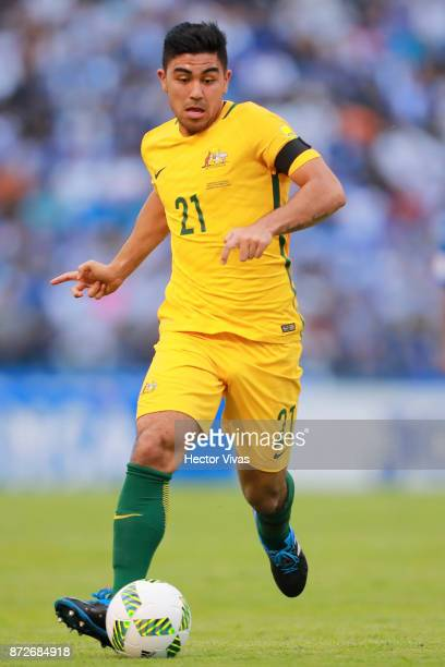 Massimo Luongo of Australia drives the ball during a first leg match between Honduras and Australia as part of FIFA World Cup Qualifiers Play Off at...