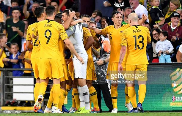 Massimo Luongo of Australia is congratulated by team mates after scoring a goal during the international friendly match between the Australian...