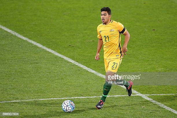 Massimo Luongo of Australia looks to passes the ball the ball during the 2018 FIFA World Cup Qualifier match between the Australian Socceroos and...