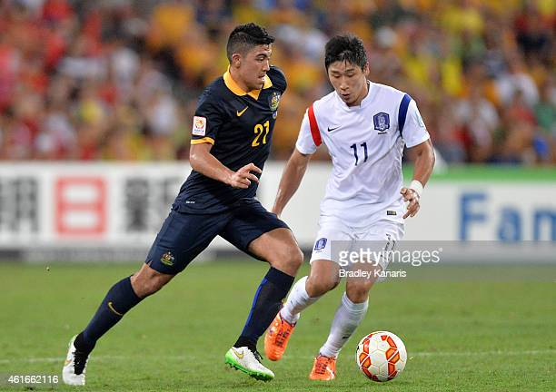 Massimo Luongo of Australia looks to take on the defence during the 2015 Asian Cup match between Australia and Korea Republic at Suncorp Stadium on...
