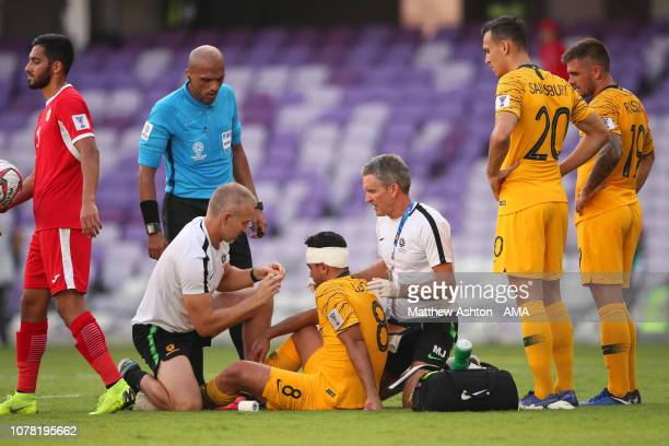 Massimo Luongo of Australia receives treatment during the AFC Asian Cup Group B match between Australia and Jordan at Hazza Bin Zayed Stadium on...