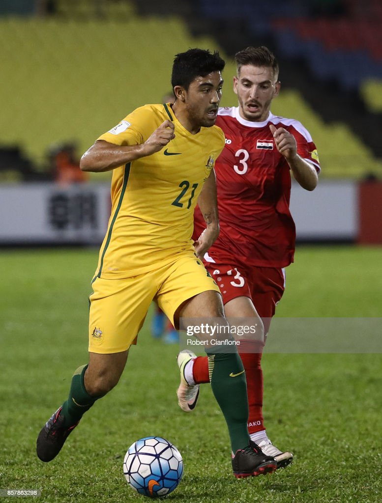 Massimo Luongo of Australia runs with the ball during the 2018 FIFA World Cup Asian Playoff match between Syria and the Australia Socceroos at Hang Jebat Stadium on October 5, 2017 in Malacca, Malaysia.