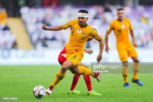 Massimo Luongo of Australia runs with the ball during the AFC Asian Cup Group B match between Australia and Jordan at Hazza Bin Zayed Stadium on...