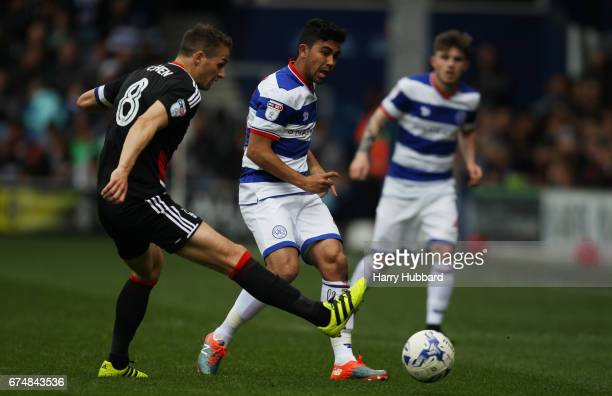 Massimo Luongo of QPR and Chris Cohen of Nottingham Forest in action during the Sky Bet Championship match between Queens Park Rangers and Nottingham...