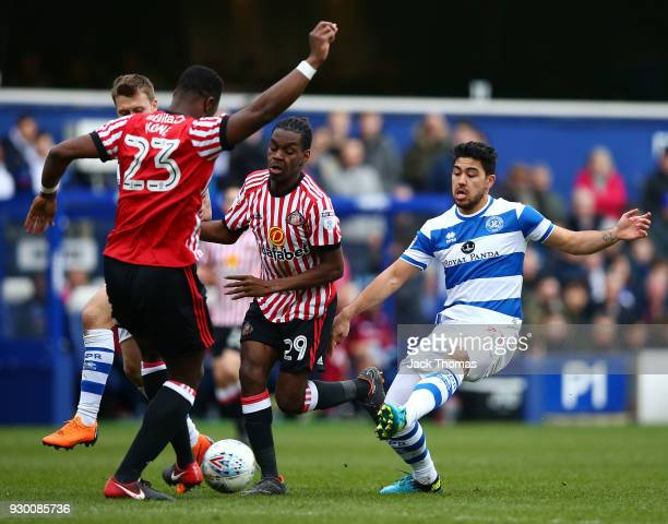 Massimo Luongo of QPR Lamine Kone and Joel Asoro of Sunderland compete for the ball during the Sky Bet Championship match between QPR and Sunderland...