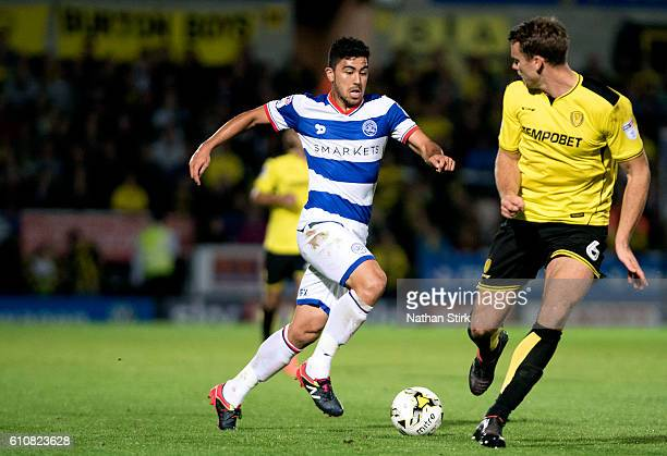 Massimo Luongo of Queens Park Rangers and Ben Turner of Burton Albion in action during the Sky Bet Championship match between Burton Albion and...