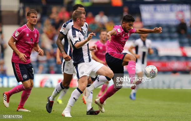 Massimo Luongo of Queens Park Rangers controls the ball as Chris Brunt challenges during the Sky Bet Championship match between West Bromwich Albion...