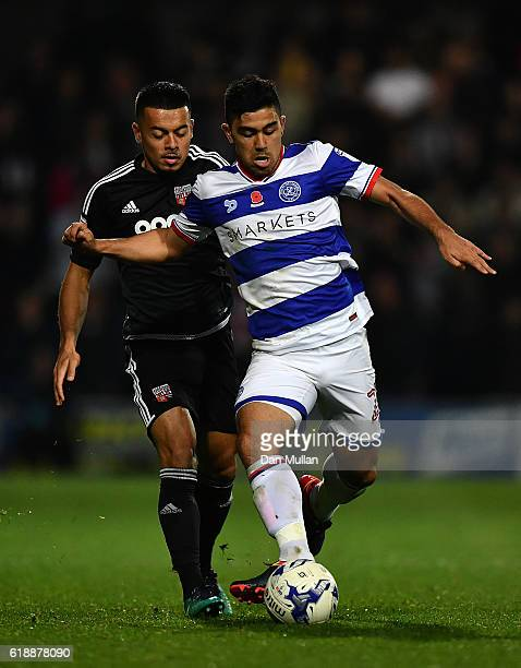 Massimo Luongo of Queens Park Rangers holds off Nico Yennaris of Brentford during the Sky Bet Championship match between Queens Park Rangers and...
