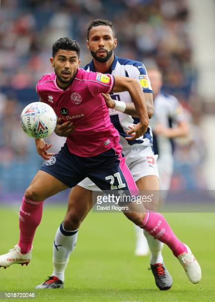 Massimo Luongo of Queens Park Rangers is challenged by Kyle Bartley during the Sky Bet Championship match between West Bromwich Albion and Queens...