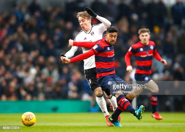 Massimo Luongo of Queens Park Rangers is challenged by Stefan Johansen of Fulham during the Sky Bet Championship match between Fulham and Queens Park...