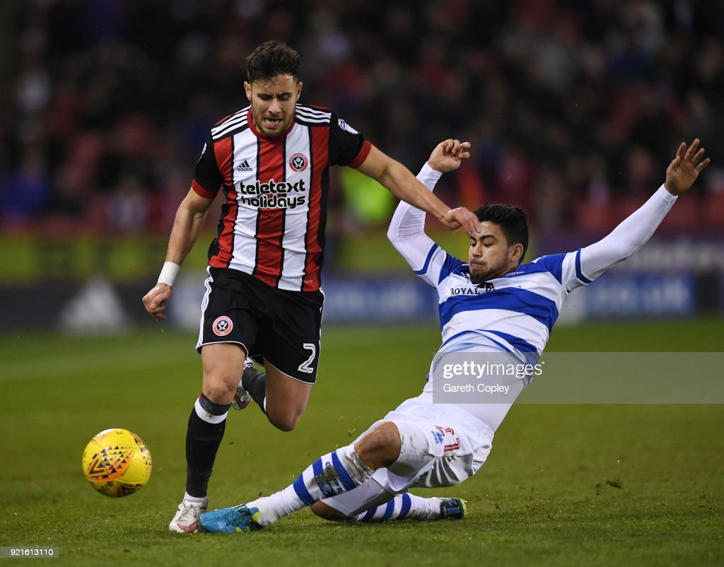 Massimo Luongo of Queens Park Rangers tackles George Baldock of Sheffield United during the Sky Bet Championship match between Sheffield United and Queens Park Rangers at Bramall Lane on February 20, 2018 in Sheffield, England.