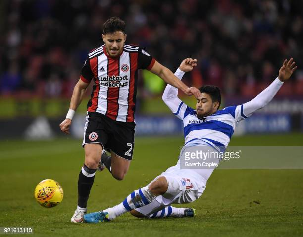 Massimo Luongo of Queens Park Rangers tackles George Baldock of Sheffield United during the Sky Bet Championship match between Sheffield United and...