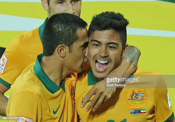 Massimo Luongo of the Socceroos is congratulated by Tim Cahill and his teammates after scoring a goal during the 2015 Asian Cup match between the...
