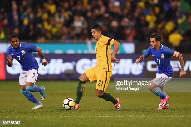 Massimo Luongo of the Socceroos kicks the ball during the Brasil Global Tour match between Australian Socceroos and Brazil at Melbourne Cricket...