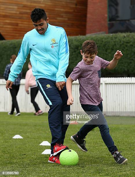 Massimo Luongo participates in a coaching clinic during the Caltex Socceroos Fan Day at North Port Oval on October 9 2016 in Melbourne Australia