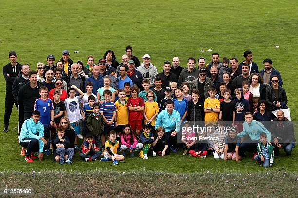 Massimo Luongo Ryan McGowan and Alex Gersbach pose for photos after a coaching clinic during the Caltex Socceroos Fan Day at North Port Oval on...