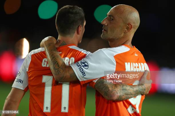 Massimo Maccarone and Corey Gameiro of the Roar congratulate each other after the game during the round 18 ALeague match between the Central Coast...