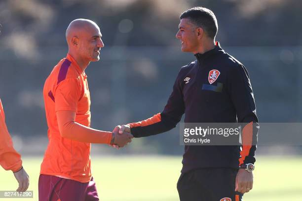 Massimo Maccarone and Roar coach John Aloisi shake hands during a Brisbane Roar training session at Ballymore Stadium on August 8 2017 in Brisbane...