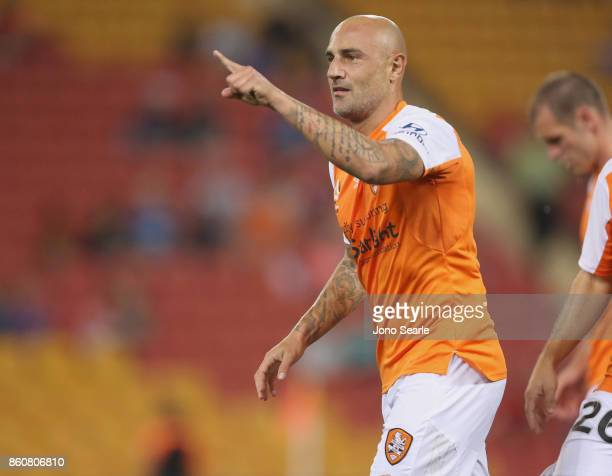 Massimo Maccarone of Brisbane celebrates his goal during the round two ALeague match between the Brisbane Roar and Adelaide United at Suncorp Stadium...