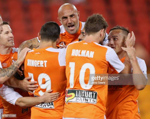 Massimo Maccarone of Brisbane Roar celebrates a Brisbane goal with team mates during the round seven ALeague match between Brisbane Roar and...